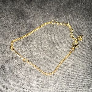Jewelry - Gold tone adjustable bracelet with bar of crystals